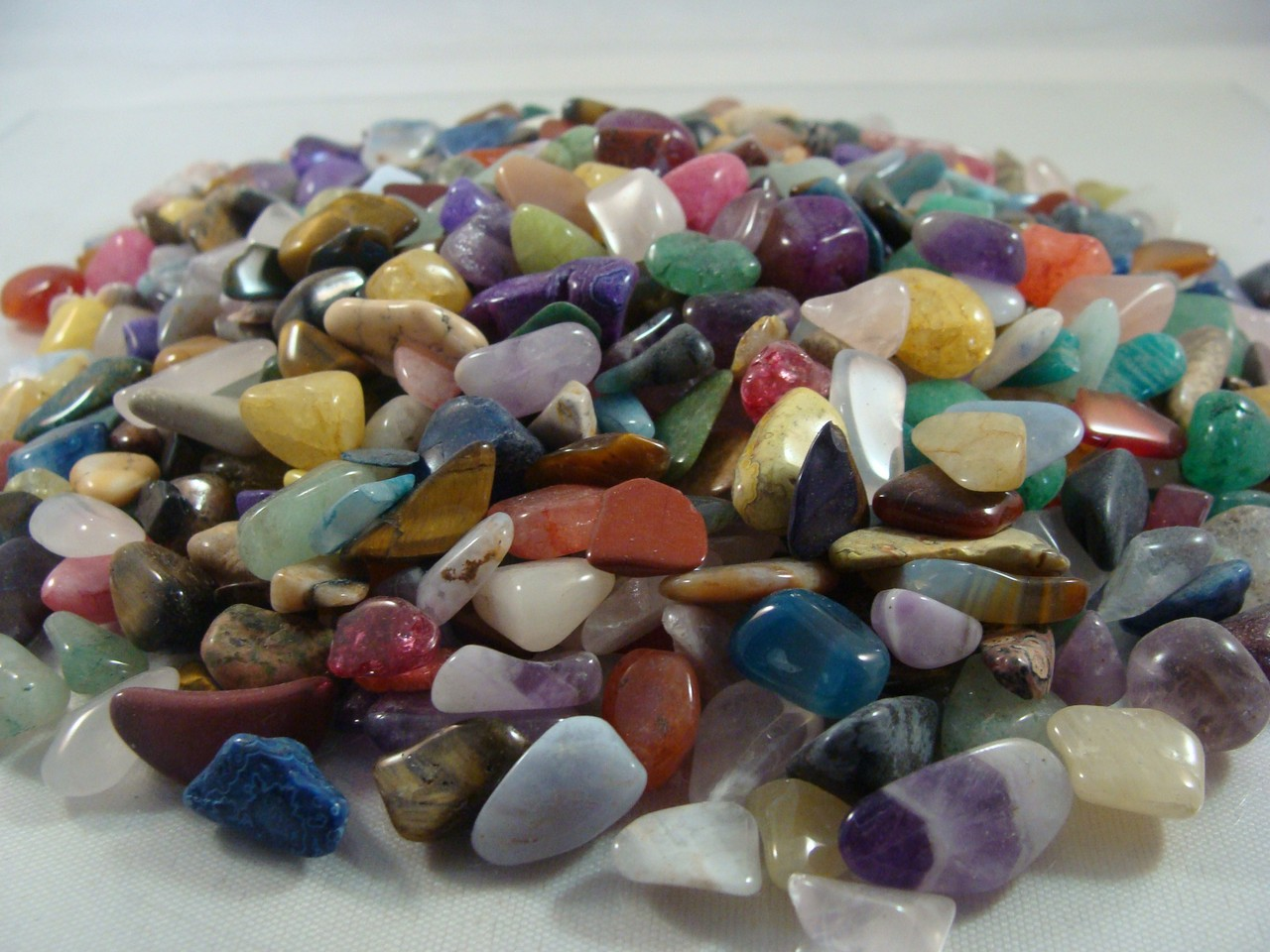 About 60. 1//4 lb pound of tumbled polished crystal gemstones and amethyst